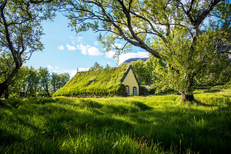 Charming mystical scene with turf roof church in old Iceland traditional style and mystical cemetery in Hof, Skaftafell,. Vatnajokull National Park. Exotic royalty free stock photography