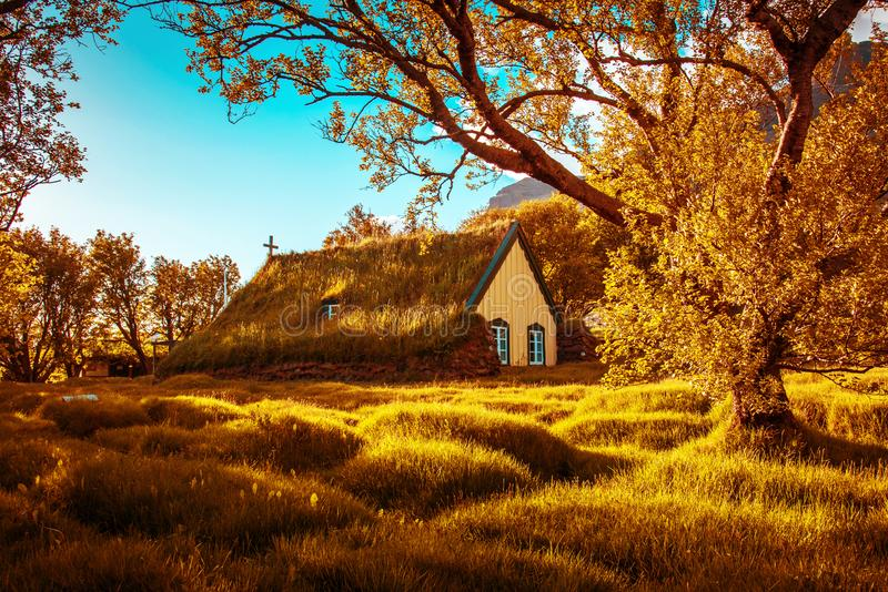 Charming mystical scene with turf roof church with windows and cemetery with small graves in Hof, Skaftafell, Vatnajokull National. Park in autumn. Exotic royalty free stock photo