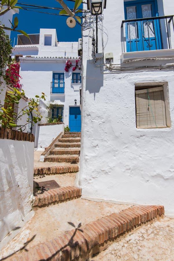 Charming narrow historic streets of white village Frigiliana. royalty free stock images