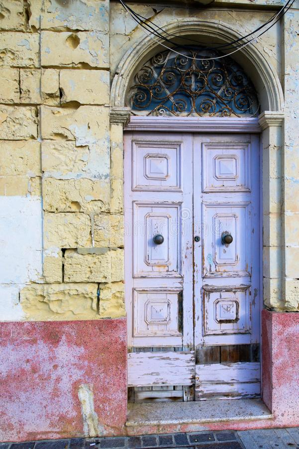 Door arch and old door on the island of Malta. royalty free stock photography