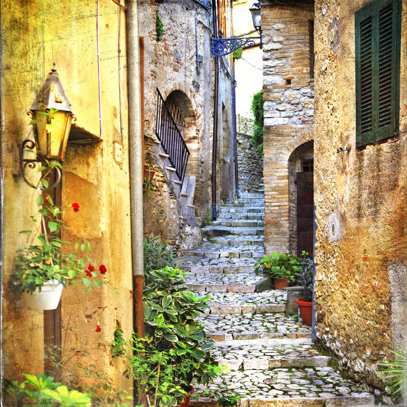 Charming old streets of mediterranean villages. Beautiful old streets of Italian villages stock photo