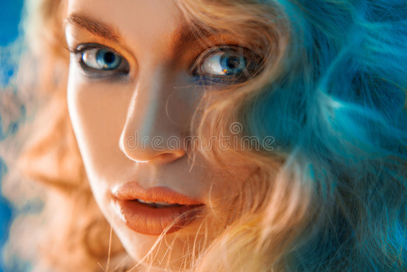 Charming portrait of woman with blue lights royalty free stock image