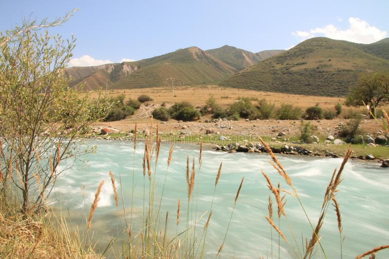 Charming river in mountains of Kyrgyzstan stock image