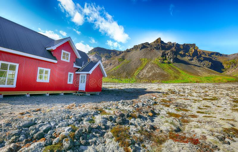 The charming rustic rural house on the mountains background in Icelandic landscape. Location: village of Hof, Skaftafell, Vatnajokull National Park, Europe stock photos