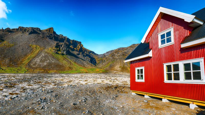 The charming rustic rural house on the mountains background in Icelandic landscape. Location: village of Hof, Skaftafell, Vatnajokull National Park, Europe royalty free stock image