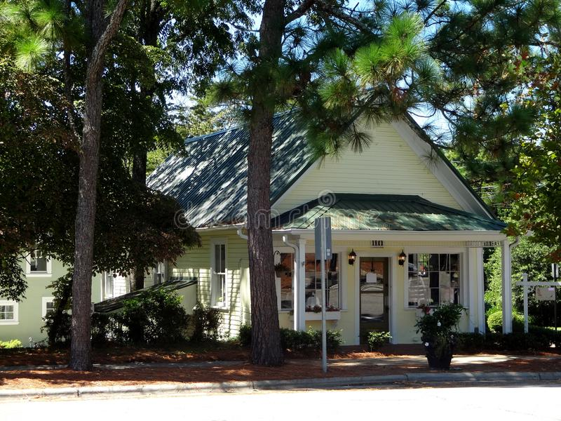 Charming Shop in Downtown Southern Pines, North Carolina. A quaint shop along a tree-lined sidewalk in downtown Southern Pines, North Carolina on a summer day royalty free stock photo