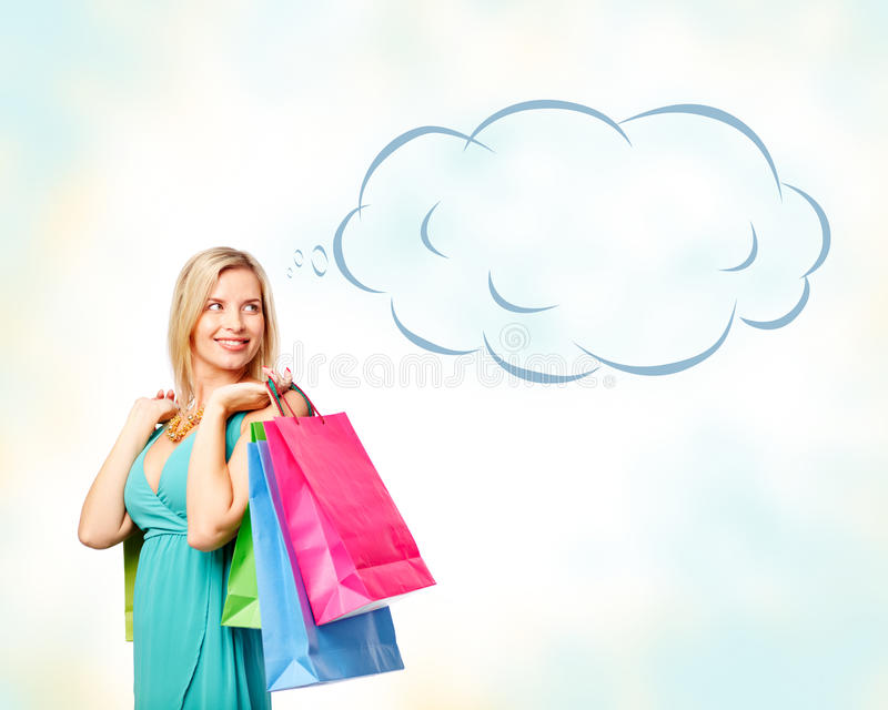Charming shopper. Portrait of happy female satisfied with her lucky shopping over white background royalty free stock photos