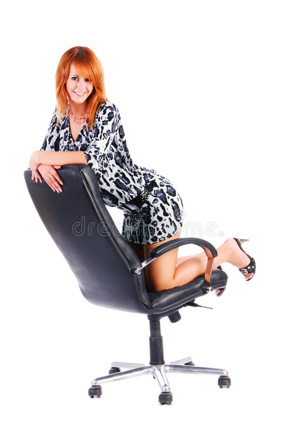 Charming smile girl on armchair stock photo