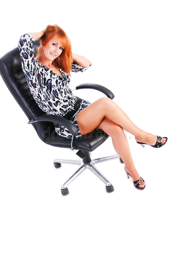 Charming Smile Girl Sits On Armchair Royalty Free Stock Photo