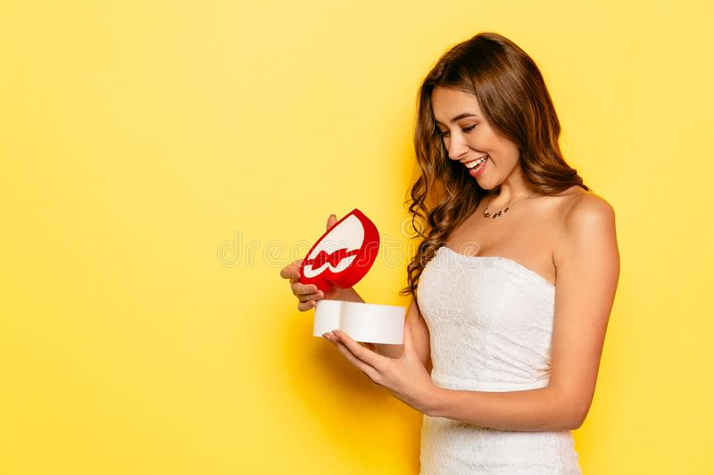 Excited girl opening gift box on Valentine`s day stock images
