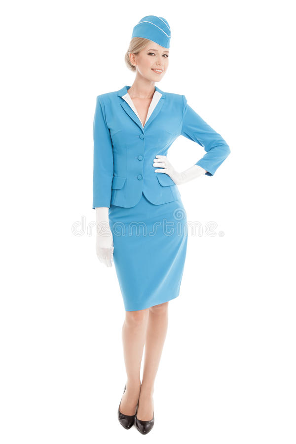 Charming Stewardess In Blue Uniform On White Background royalty free stock photos