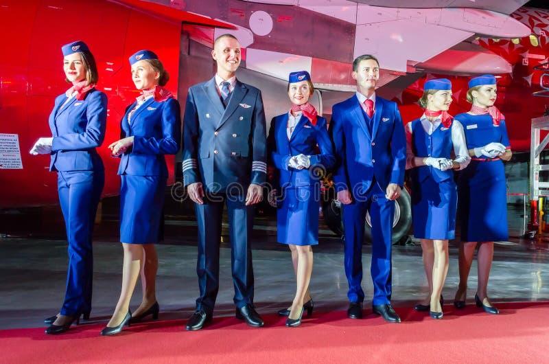 Charming Stewardess and stewards Dressed In Uniform. Russia, Saint-Petersburg. 23 November, 2017. stock photos
