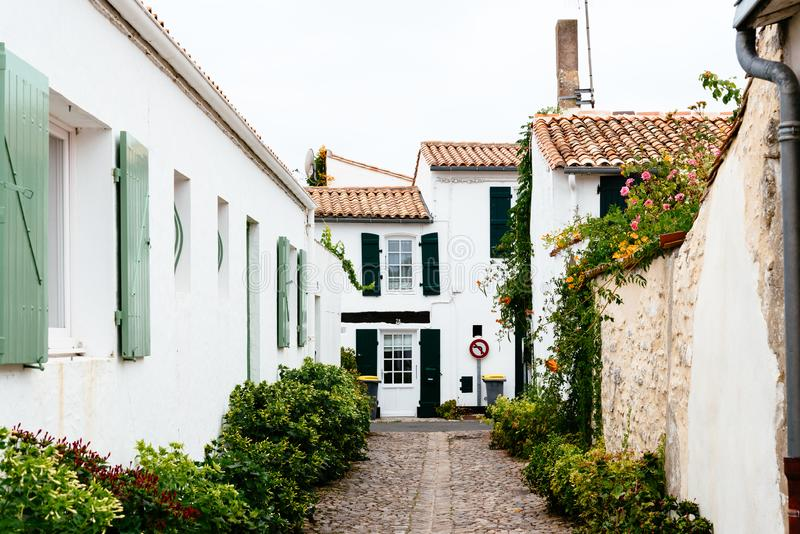 Charming street with traditional old houses and flowers stock photos