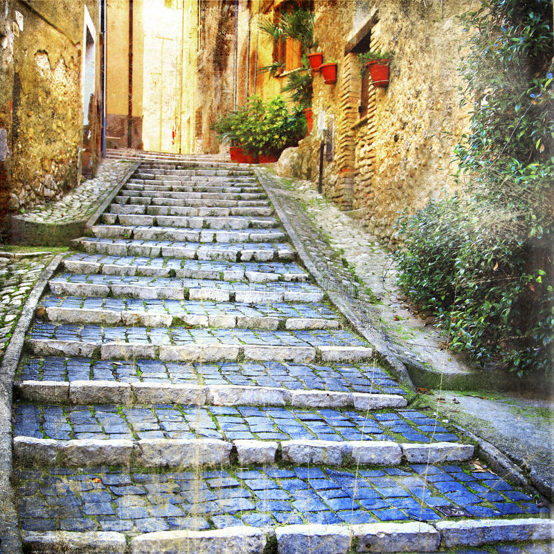 Charming streets of old villages. Beautiful streets of old italian villages stock photo