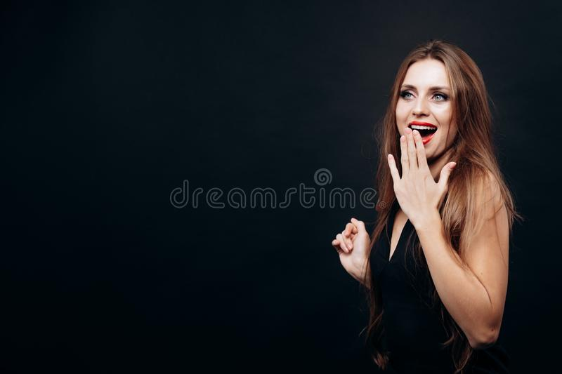 Charming Surprised Young Woman Posing Covering Her Mouth With Hand royalty free stock photos