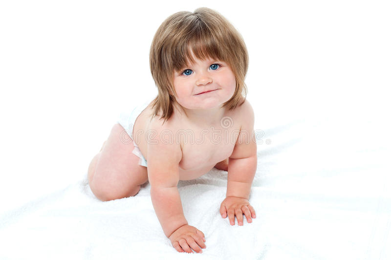 Download Charming Toddler In Diapers Trying To Crawl Stock Image - Image: 27260883
