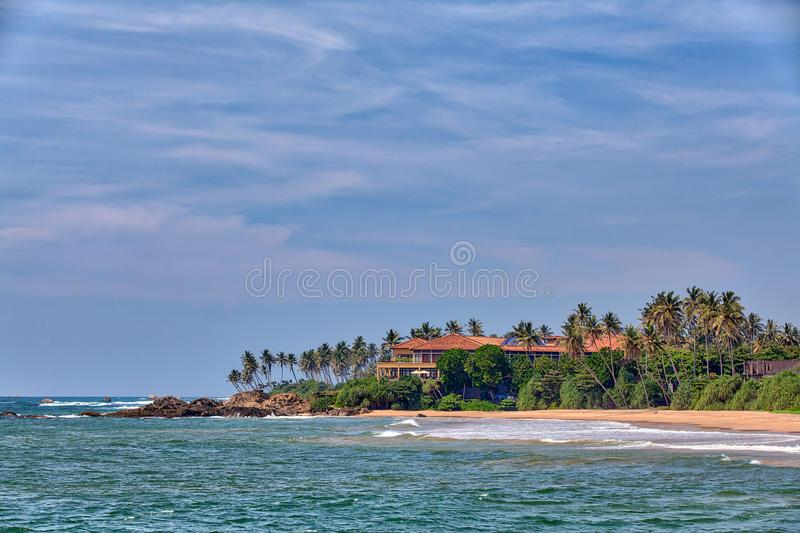 Charming view from the Galle Fortress to the opposing coast. With attractive buildings on the tropical island Sri Lanka in Asia in the Indian Ocean stock image