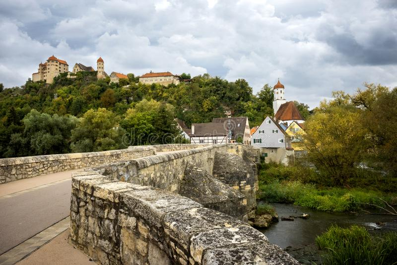 View on the Harburg Castle from the bridge over the river of Wornitz in the city of Harburg in Bavaria, Germany. royalty free stock photography