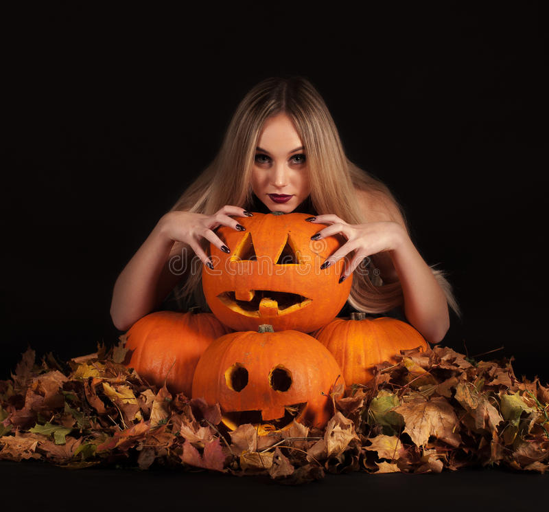 Charming Witch With Funny Pumpkins And Leaves Stock Photo