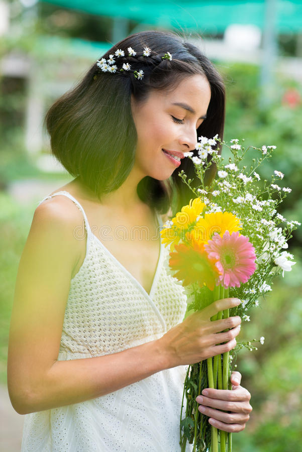 Charming woman with flowers royalty free stock photography