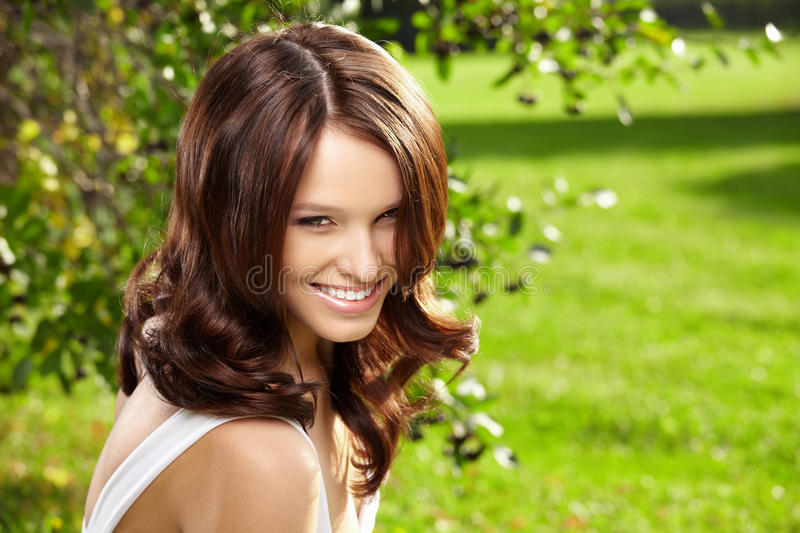 Charming woman in a garden royalty free stock image