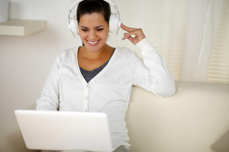 Charming woman with headphone listening music stock photography