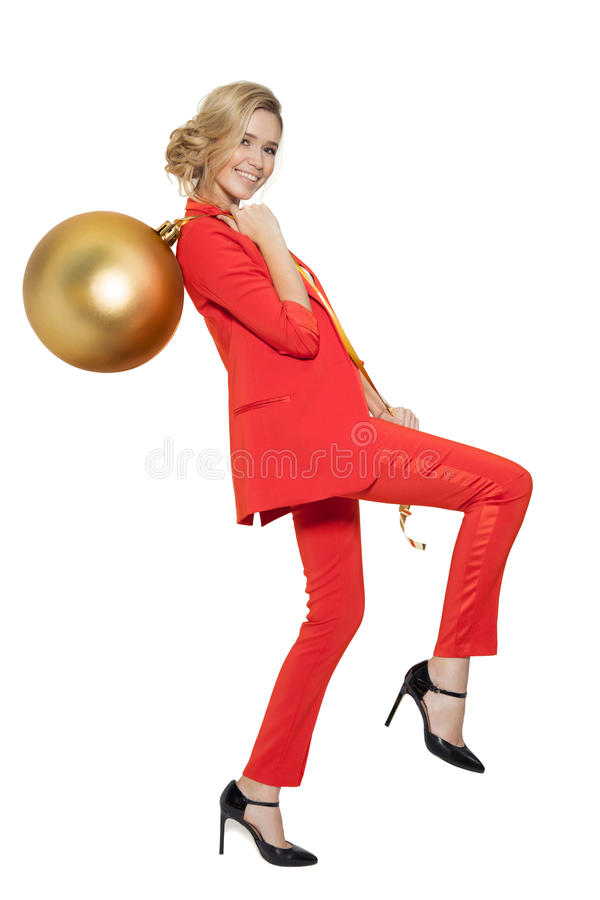 Charming Woman Holding Big Golden Tree Ball. Happy New Year. Marry Christmas. Isolated stock photography