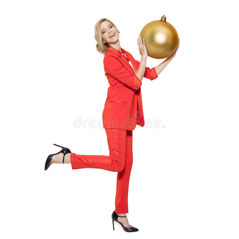 Charming Woman Holding Big Golden Tree Ball. Happy New Year. Marry Christmas. Isolated royalty free stock photo