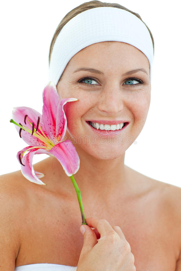 Charming woman holding a flower royalty free stock photo