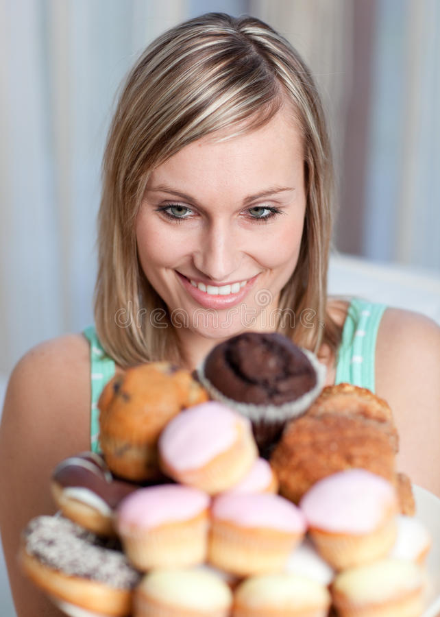 Download Charming Woman Holding A Plate Of Cakes Stock Images - Image: 14141884