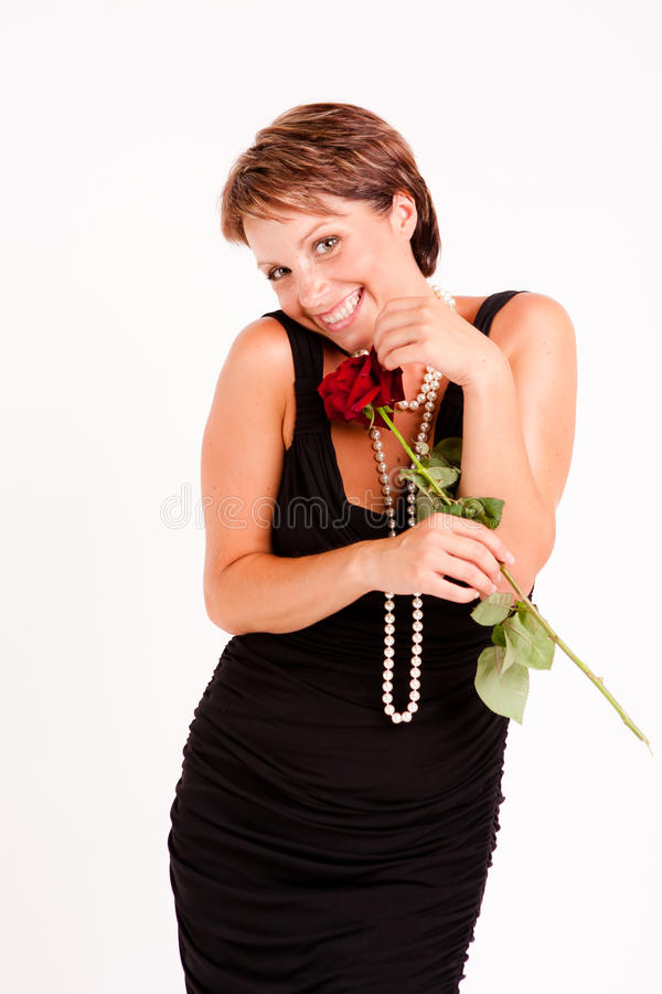 Charming woman with red rose royalty free stock images