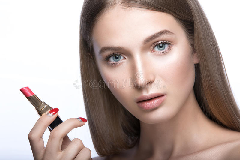 Charming young babe with lipstick and light makeup. Beauty face royalty free stock photography