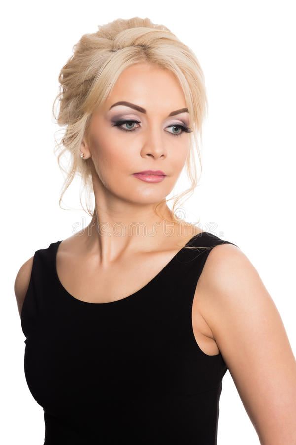 Charming young blonde in a black dress royalty free stock image