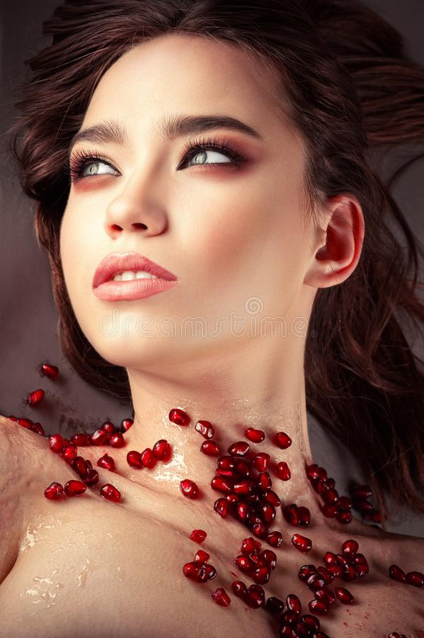Charming young brunette girl with beautiful makeup royalty free stock photography