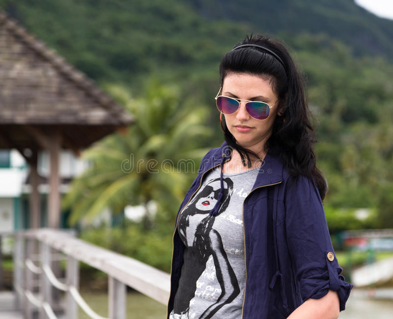 Charming young brunette in sunglasses royalty free stock images
