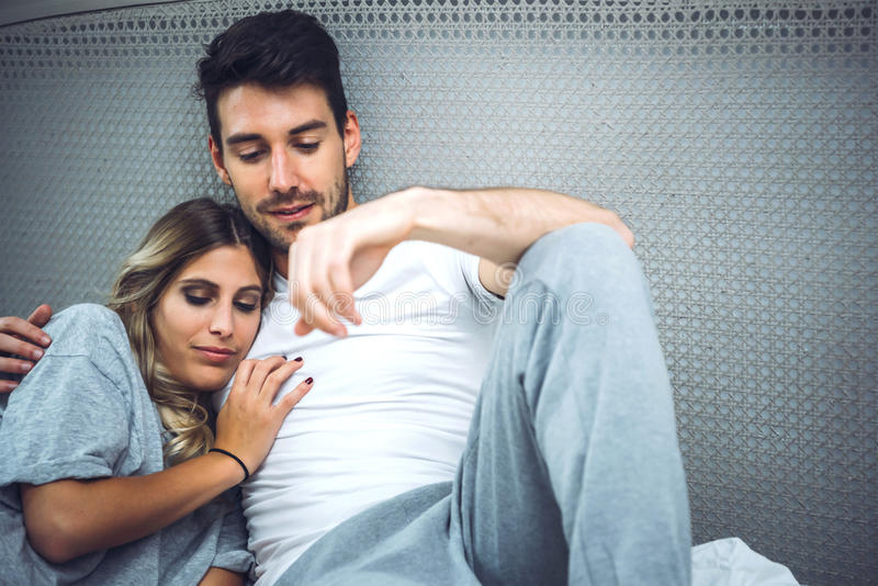 Charming young couple embracing stock images