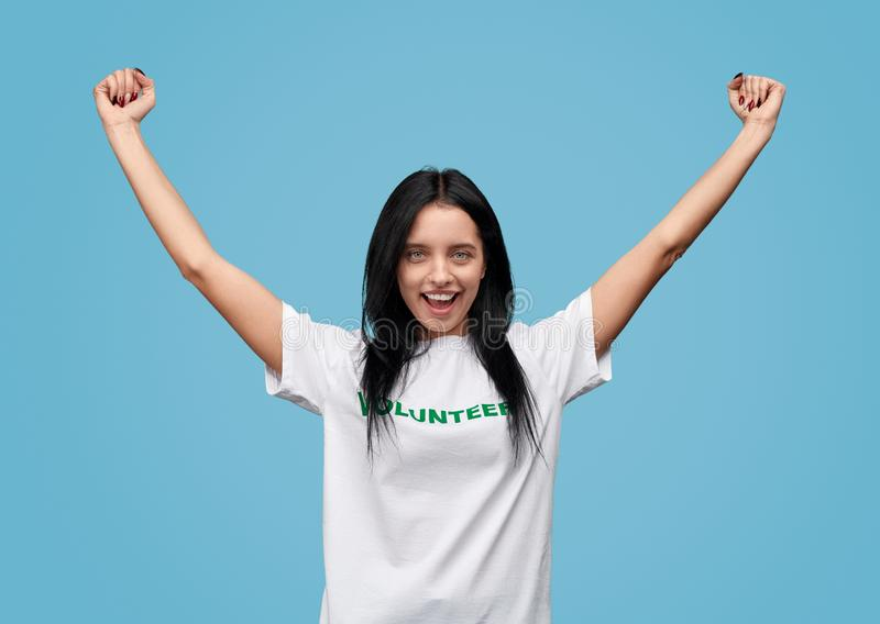 Young volunteer celebrating success royalty free stock images
