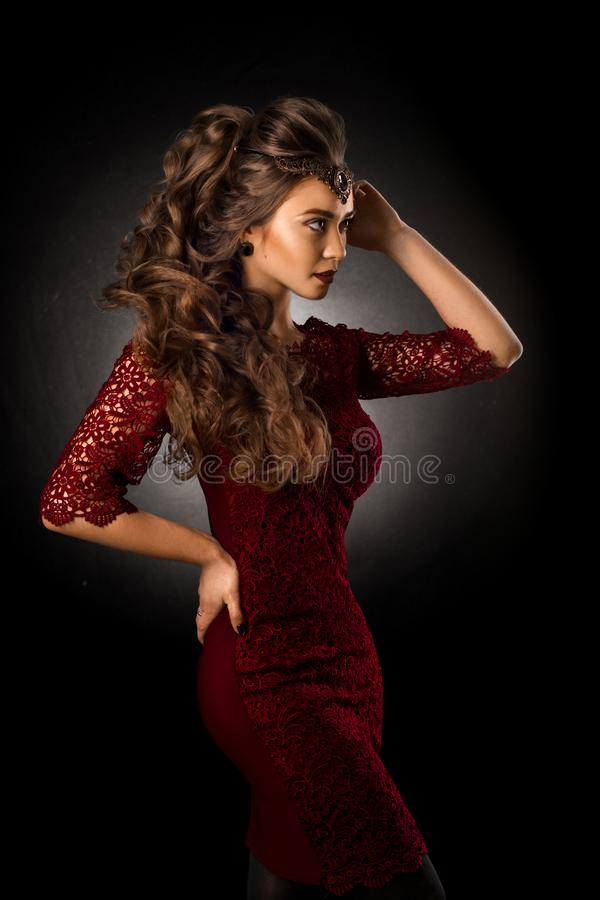 Charming young girl with beautiful curly hairstyle stock photo