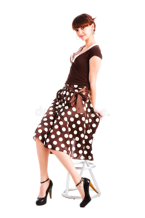 Download Charming Young Girl On Chair In Spotted Skirt Stock Image - Image: 12883219