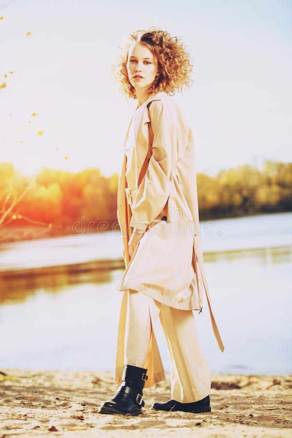 Fashionable girl in nature royalty free stock images