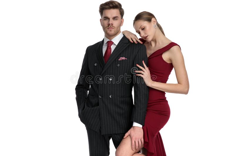 Charming young guy holding his girlfriend`s leg royalty free stock photos