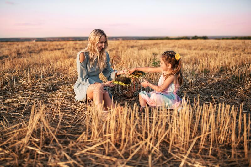 Charming young mother and pretty daughter royalty free stock image