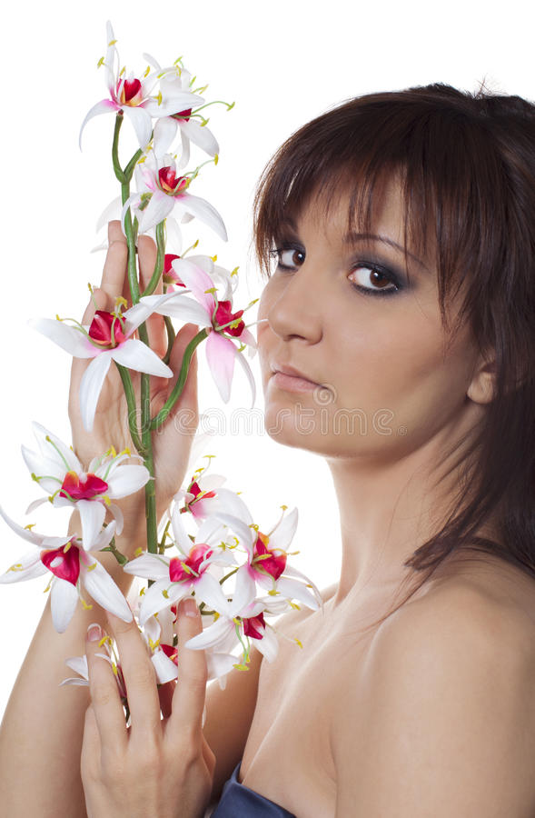 Charming young woman with flower orchids stock photography
