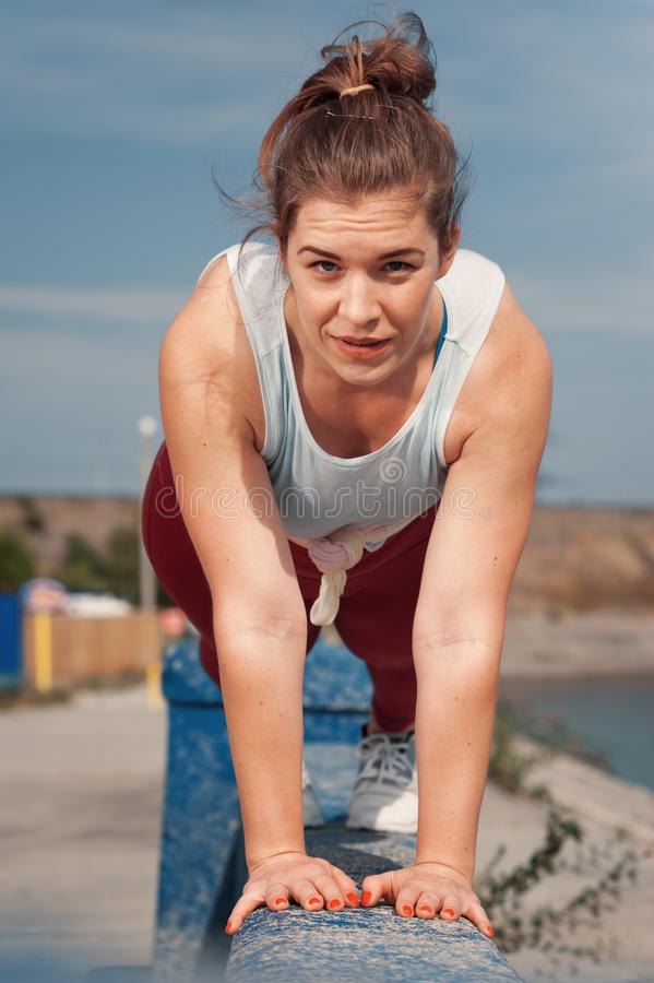 Charming young woman training core muscles royalty free stock photos