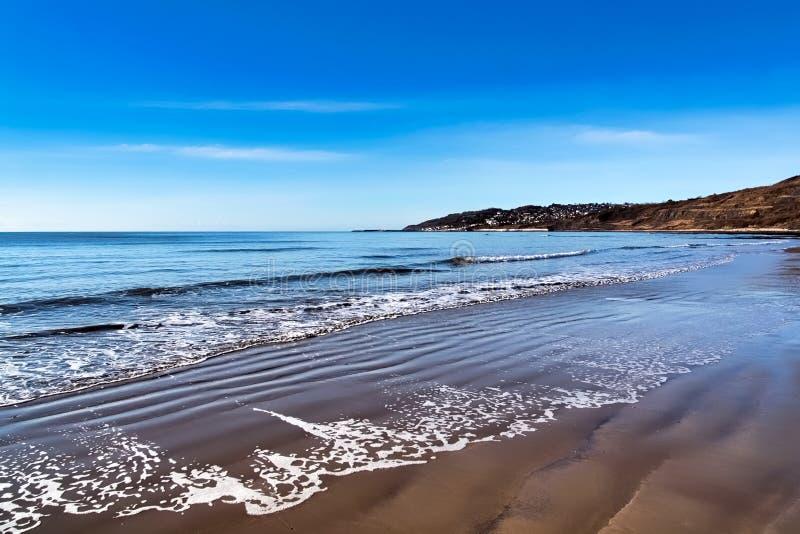 Charmouth mit Lacy Patterns im Sand stockbilder