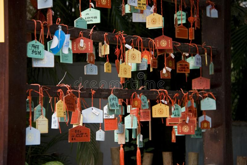 Charms on a wall. Charms near the temple in Sanya. Haynan, China stock photo