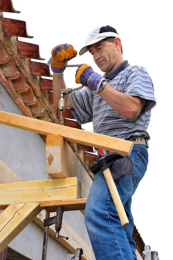 Charpentier de travail du bois photo stock