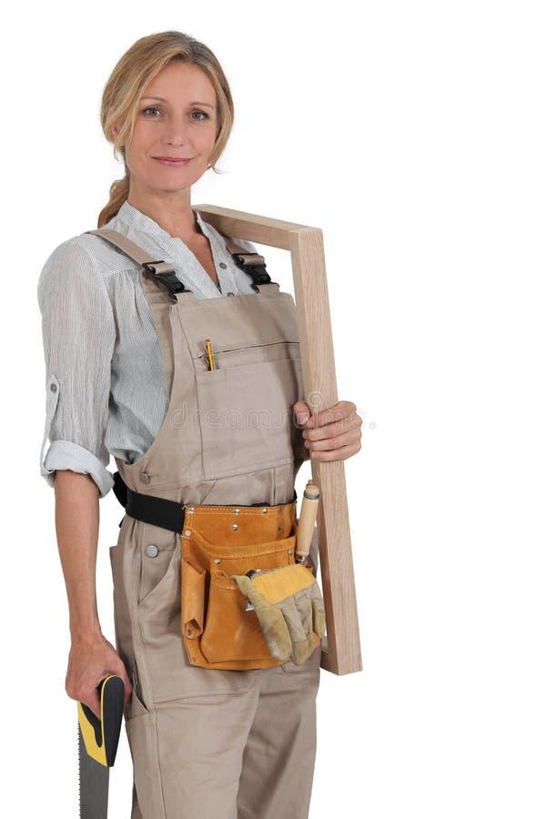 Charpentier féminin photo libre de droits