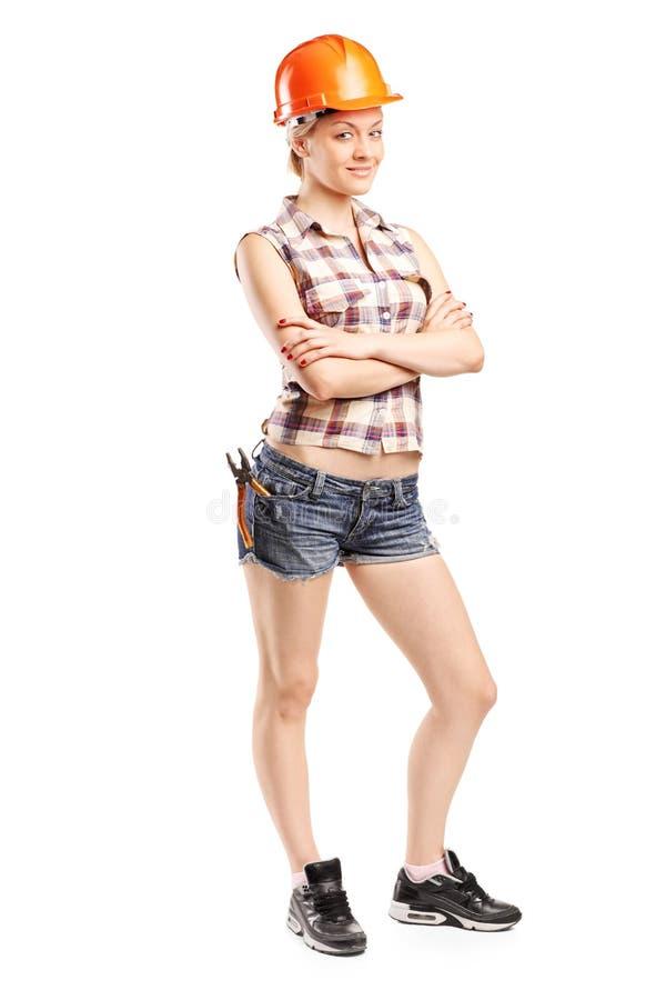 Charpentier féminin attirant photographie stock