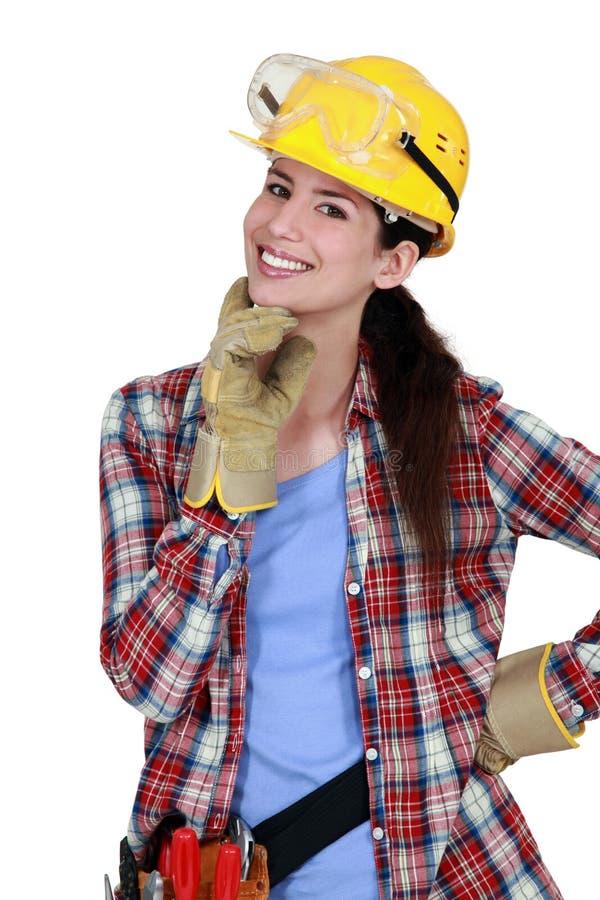 Charpentier féminin heureux photos stock